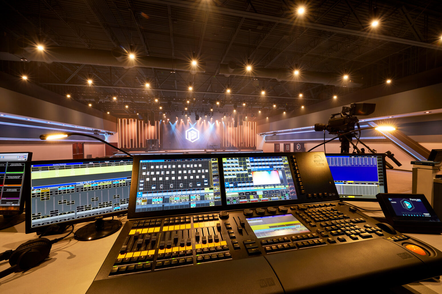 We train clients on our auditorium lighting systems controls like these.